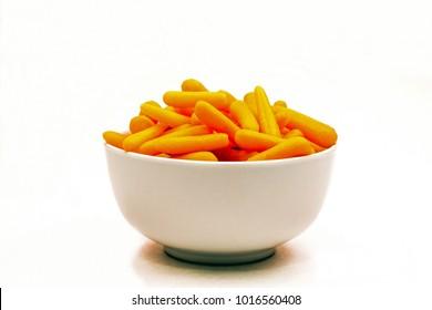White Ceramic Bowl Full of Orange Baby Carrots