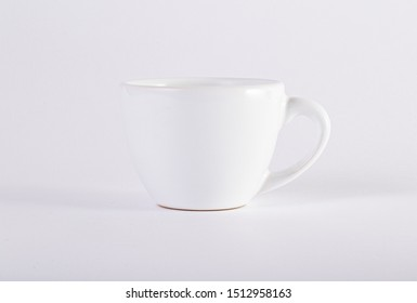 White ceramic coffee cup on white background
