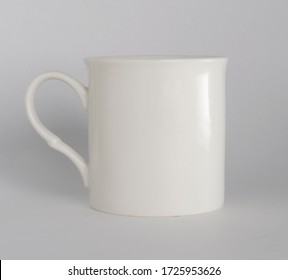 White ceramic Cup on a light background close up