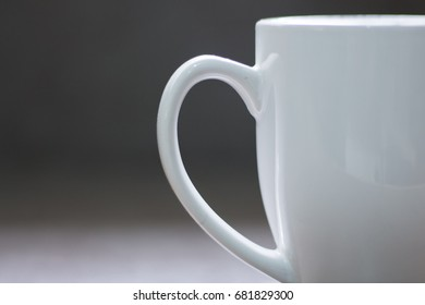 White Ceramic Cup on Neutral Gray Background