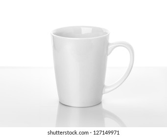 White ceramic cup stands on table above white background