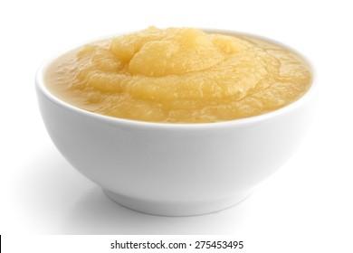 White ceramic dish of apple sauce on white.