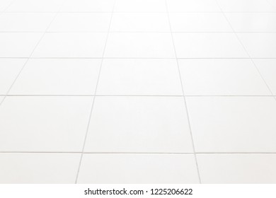 White ceramic floor tiles for the decoration of the bedroom.