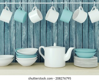 White ceramic kitchenware on the wooden shelf in front of blue old wood wall.