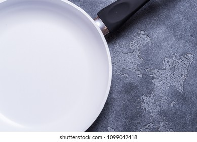 White ceramic pan on grey background