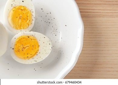 White ceramic plate with hard boiled eggs on table. Nutrition concept