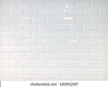 White ceramic tiles wall for background.