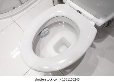 White ceramic toilet in the bathroom. Clean toilet.