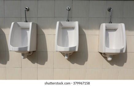 white ceramic of urinals in men's bathroom,sanitary ware for men.