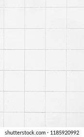 White ceramic wall tiles texture for the decoration of the bedroom.