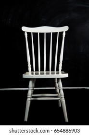 white chair in black background