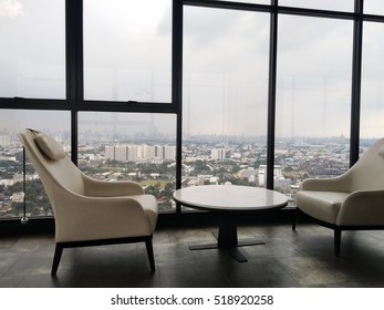 The white chair with city view in background