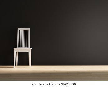 White chair to face a blank black wall - left of the view field