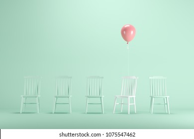 White chair with floating pink balloon among green chair on pastel green background. minimal idea concept.
