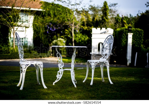 white chair and table in garden. English vintage style
