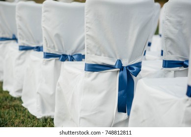 White chairs in a beautiful wedding ceremony. Wedding.