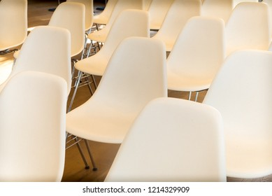 white chairs (empty) at conference room