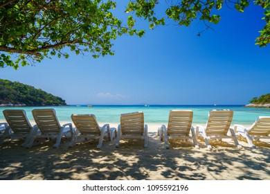 White chairs on the tropical beach