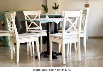 White chairs and a table in a restaurant
