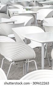 White chairs and tables geometry close-up