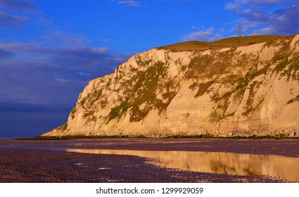 White chalk cliff of Cap Blanc Nez on the coast of France at the Strait of Dover (Pas de Calais) during sunset