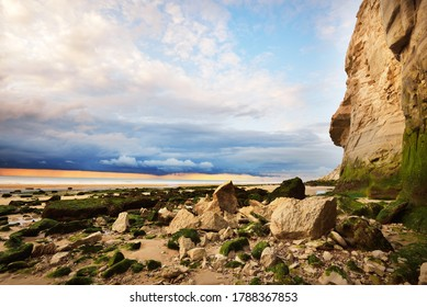 White chalk cliff of Cap Blanc Nez on the coast of France at the Straight of Dover (Pas de Calais) during sunset. Dramatic evening sky. Travel destinations, cruise, landmarks theme