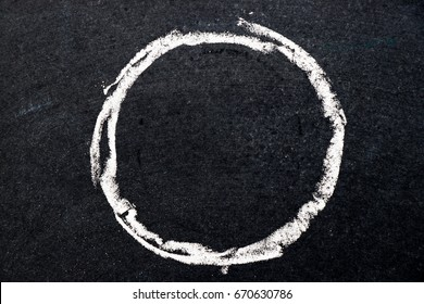 White chalk drawing as circle shape on black board background (Use for decoration, bubble speech, rubber stamp)