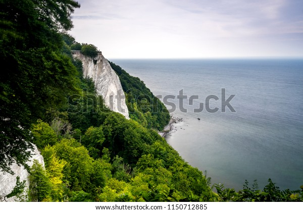 White chalk rocks surrounded by the thick forest of Jasmund National Park of the island Ruegen, Germany
