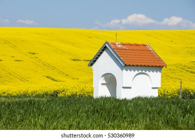 white chapel in colored fields