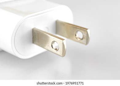 White charge adapter with US socket close up photo on white and silver background