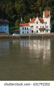 White chateau on banks of   the Danube River near  Melk, Austria
