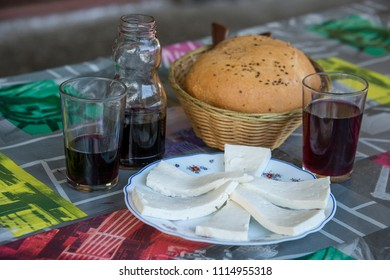 White cheese, bread and red wine in a restaurant in the north of Tenerife, Canary Islands, photo with selective focus