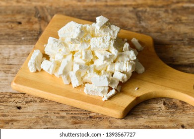 White cheese on a wooden board