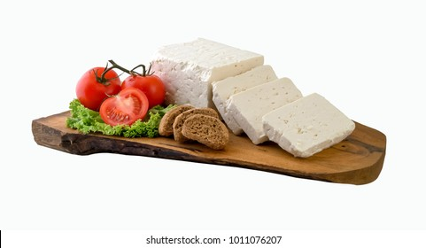 White cheese and pieces on natural wooden board. Clipping path.