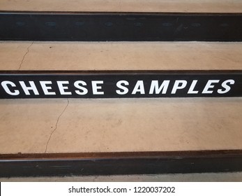 white cheese samples sign on black and grey cement stairs