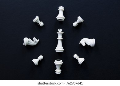 White chess figures on black background flat lay photo. White chess figures abstract ornament. Chess on table flat lay. Chess clock top view photo. Checkmate game banner template. Intellectual sport