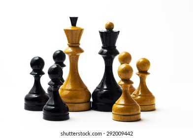 White chess king and black queen with the few black and white pawns and black queen on a white background