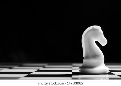 white chess knight on background