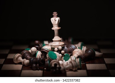 white chess on the top of number of chess pieces , business strategy concept