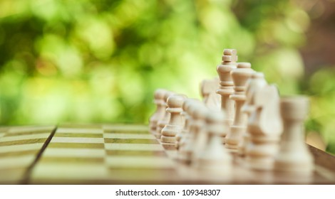 white chess pieces on the board
