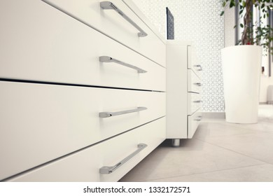 White chest with drawers and silver handles