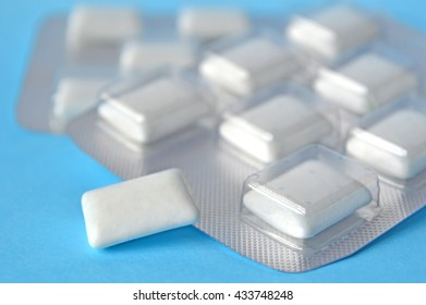 White chewing gum on blue background
