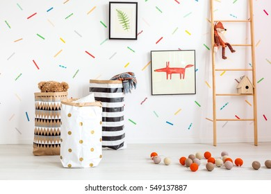 White child room with decorative cotton balls and toys