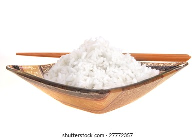white china cooked rice and wood sticks