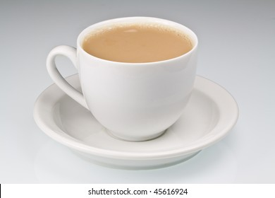 White china cup of tea with milk on a plain background