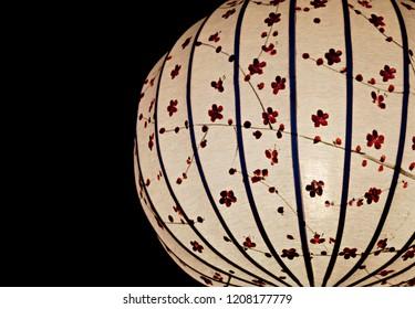 White Chinese lantern over black background