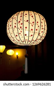 White Chinese lantern over black background