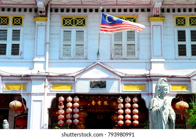 White Chinese Shophouse with a Malaysian Flag - December 2017 - George Town, Penang, Malaysia