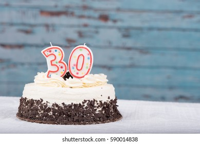 White and chocolate cake with 30 candles