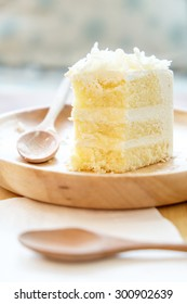 White chocolate cake in wooden plate